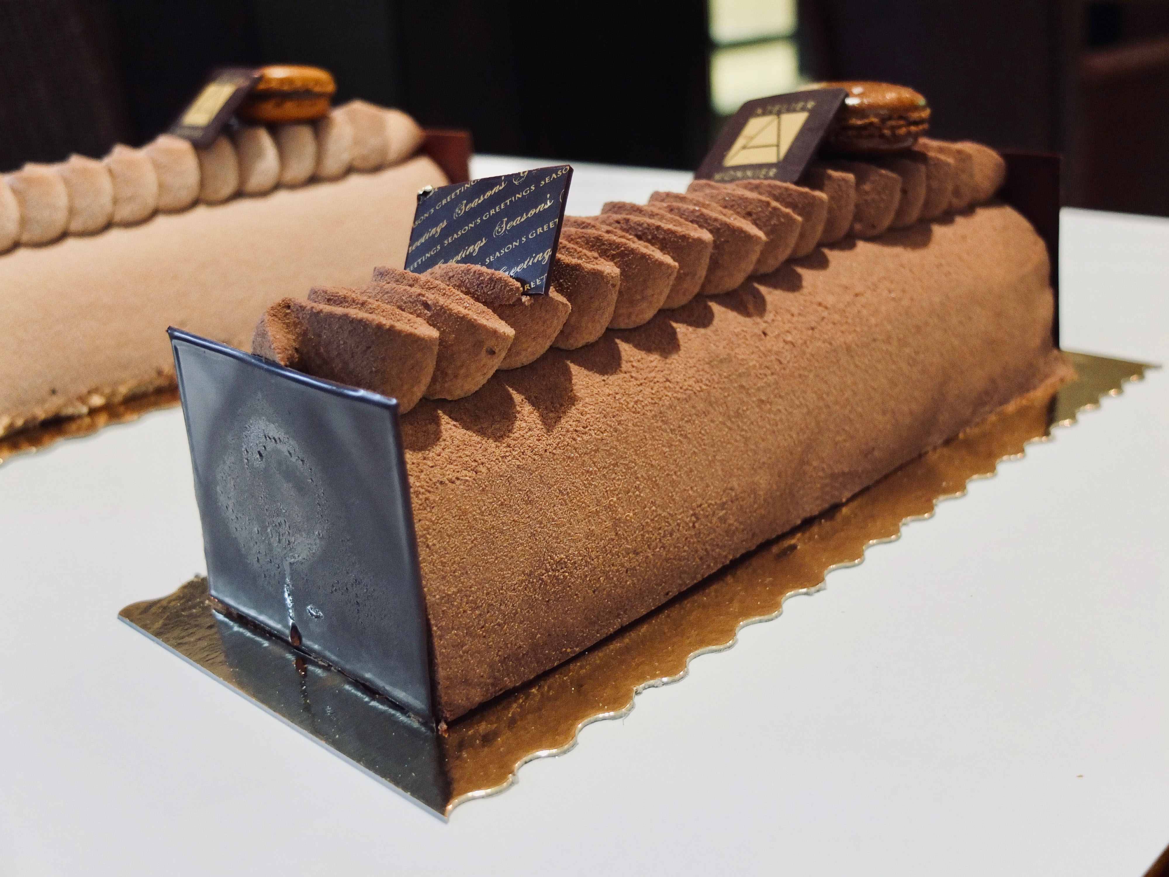 How to choose your Yule Log ? Buche de Noel - French Bakery in Miami, French restaurant miami, French food miami, café miami, coffee shop miami, catering miami, dadeland, pinecrest, brickell, south beach, miami beach, millefeuille, raspberry tart, carré crunchy, hazelnut cake, macaron, macarons, macaroons, macaroon, french macarons, parisian macarons, chocolates, chocolate truffle, belgian chocolates